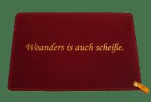 Dreckstückchen de luxe mit Aufdruck 'Woanders is auch scheiße.'